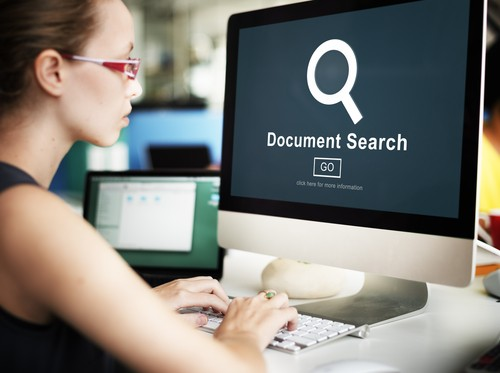 Woman at the office searching for documents