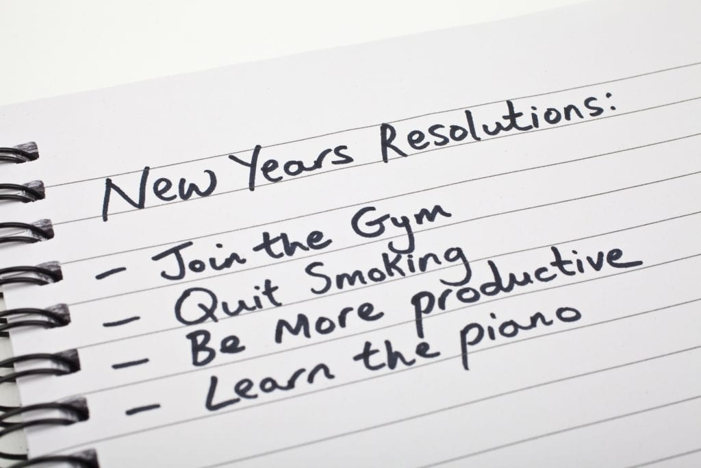 new year's resolution list written on a notebook