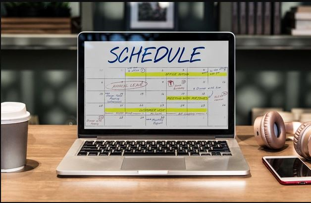 time blocking and scheduling a laptop showing a typical schedule with blocked out hours on calendar