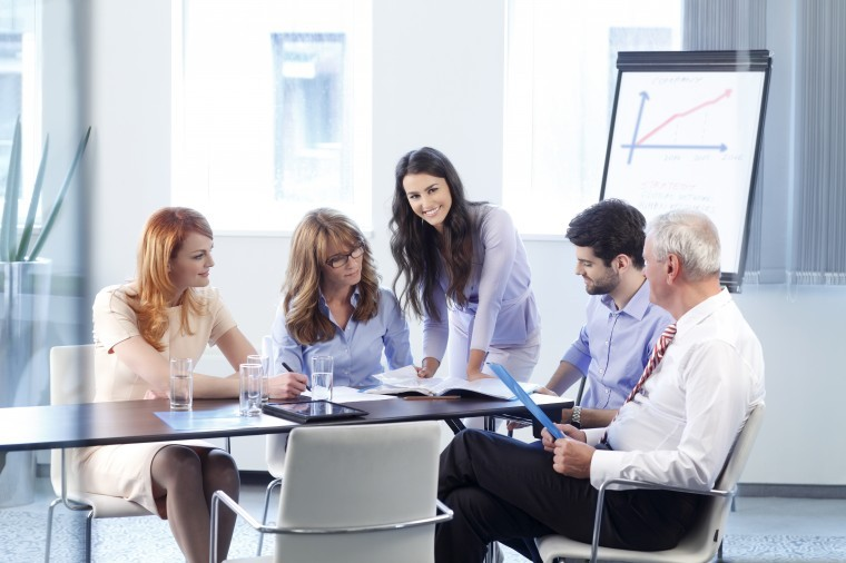 business people discussing in a meeting with their office leader